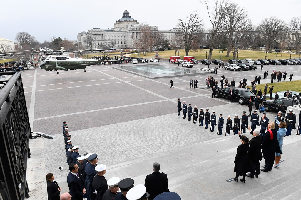 . President Donald Trump, first lady Melania Trump, Vice President Mike Pence, and Karen Pence wave as former President Barack Obama and Michelle Obama depart Capitol Hill in Washington, Friday, Jan. 20, 2017, during the presidential inauguration. (Jack Gruber/Pool Photo via AP)