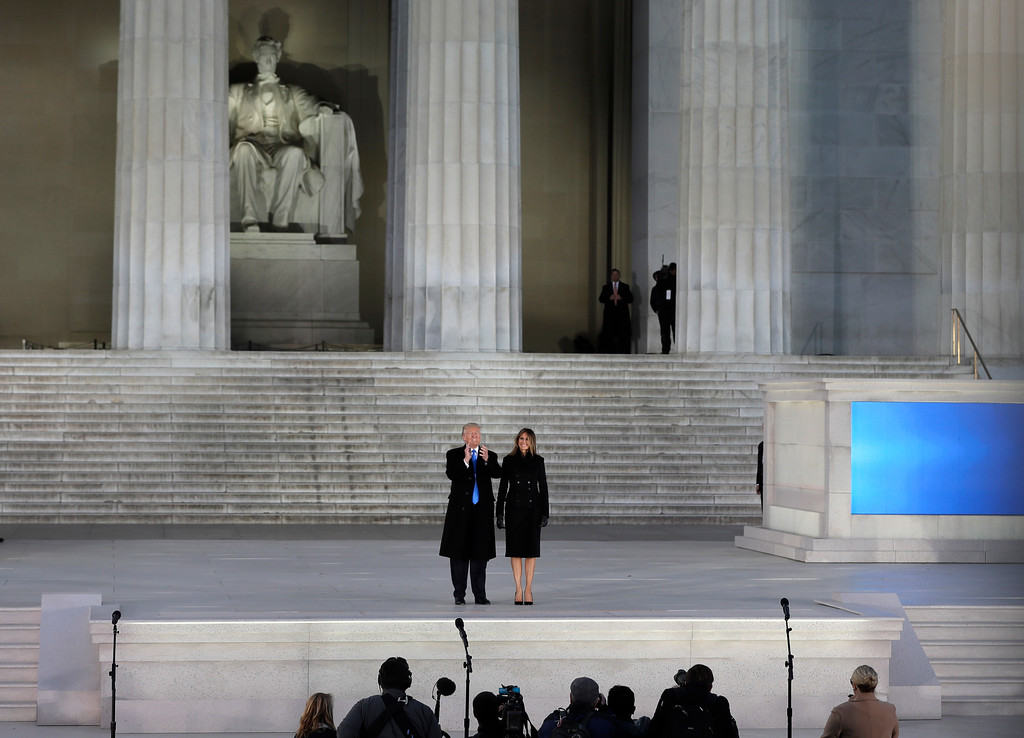""". President-elect Donald Trump and his wife Melania Trump stand on stage at the end of a pre-Inaugural \""""Make America Great Again! Welcome Celebration\"""" at the Lincoln Memorial in Washington, Thursday, Jan. 19, 2017. (AP Photo/David J. Phillip)"""