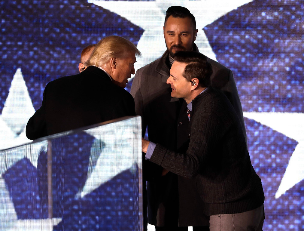 """. President-elect Donald Trump greets 3 Doors Down after they performed at a pre-Inaugural \""""Make America Great Again! Welcome Celebration\"""" at the Lincoln Memorial in Washington, Thursday, Jan. 19, 2017. (AP Photo/David J. Phillip)"""