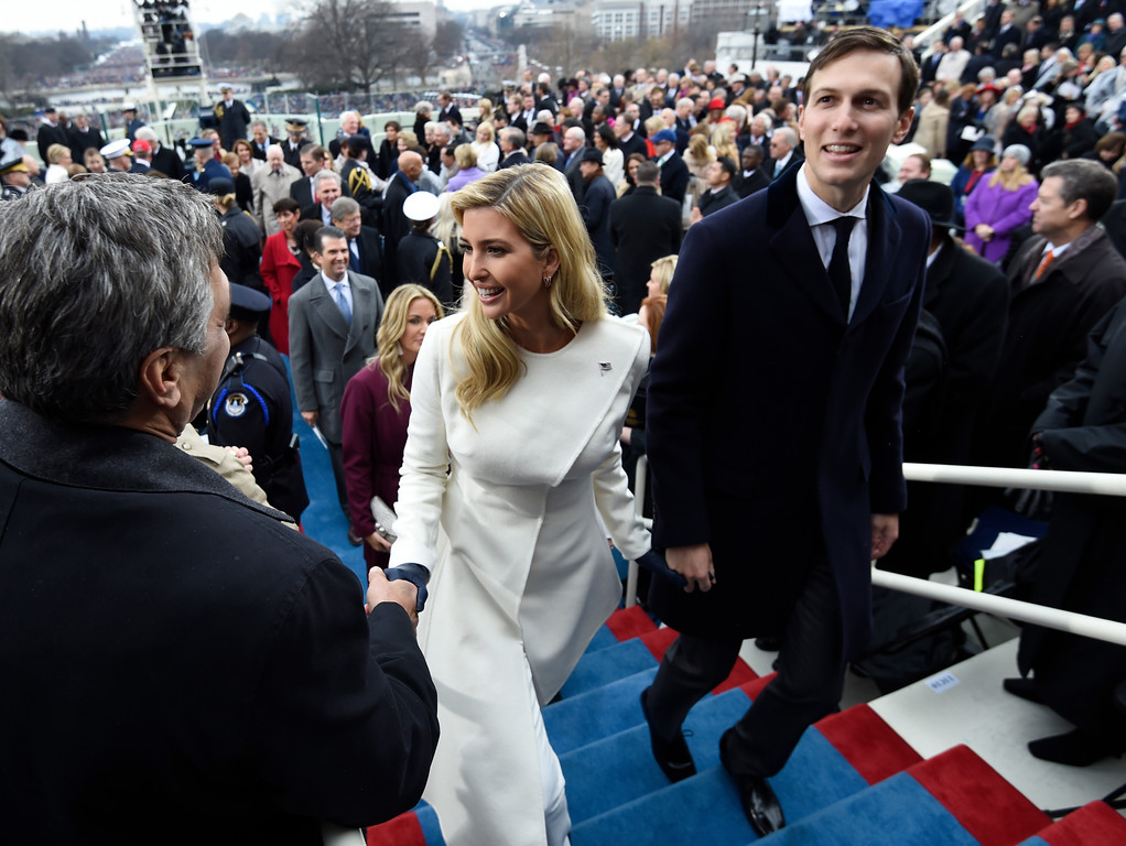 . Ivanka Trump and husband Jared Kushner leave after the Presidential Inauguration at the US Capitol in Washington, DC, on January 20, 2017. / AFP PHOTO / POOL / SAUL LOEB