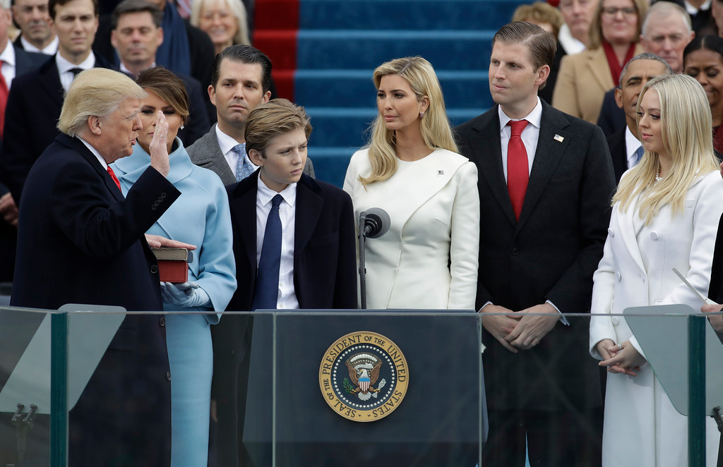 . Donald Trump is sworn in as the 45th president of the United States by Chief Justice John Roberts as Melania Trump and his children look on during the 58th Presidential Inauguration at the U.S. Capitol in Washington, Friday, Jan. 20, 2017. (AP Photo/Patrick Semansky)