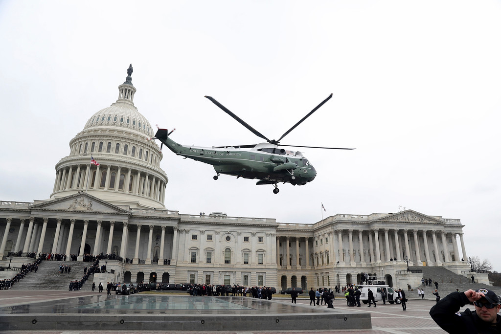 . A military helicopter carries former president Barack Obama and Michelle Obama from the Capitol in Washington, Friday, Jan. 20, 2017, en route to Andrews Air Force Base, Md. during the inauguration ceremony Donald Trump. (Rob Carr/Pool Photo via AP)