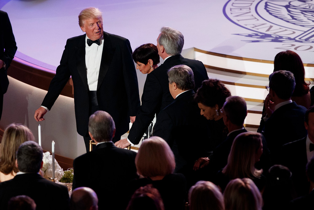 . President-elect Donald Trump talks with guests after speaking at a VIP reception and dinner with donors, Thursday, Jan. 19, 2017, in Washington. (AP Photo/Evan Vucci)