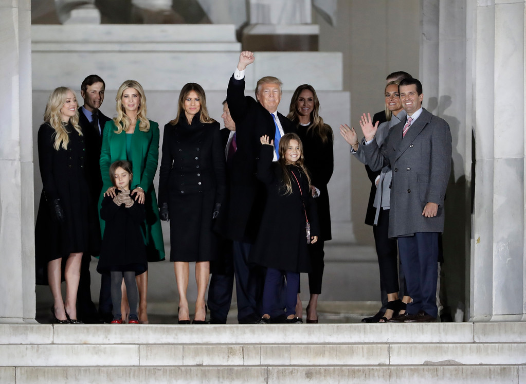 """. President-elect Donald Trump and his wife Melania Trump and family wave at the conclusion of the pre-Inaugural \""""Make America Great Again! Welcome Celebration\"""" at the Lincoln Memorial in Washington, Thursday, Jan. 19, 2017. (AP Photo/David J. Phillip)"""