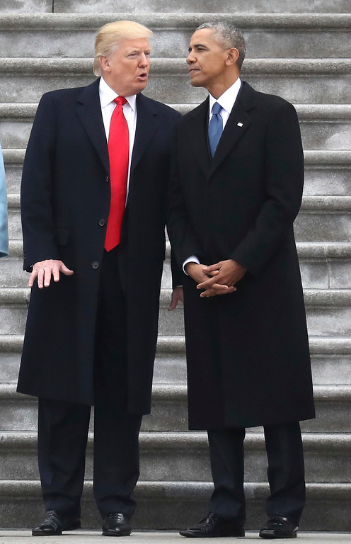 . Donald Trump and talks with former president Barack Obama on Capitol Hill in Washington, Friday, Jan. 20, 2017, prior to Obama\'s departure to Andrews Air Force Base, Md.  (Rob Carr/Pool Photo via AP)