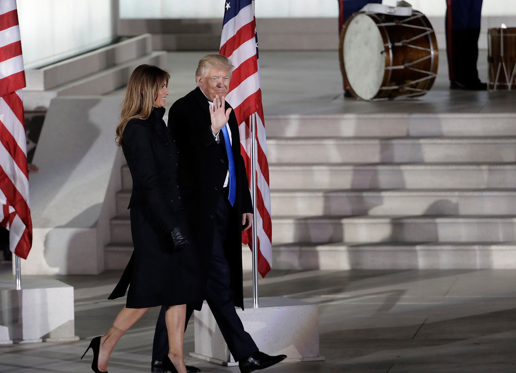 ". President-elect Donald Trump and his wife Melania Trump walk at a pre-Inaugural ""Make America Great Again! Welcome Celebration\"" at the Lincoln Memorial in Washington, Thursday, Jan. 19, 2017. (AP Photo/David J. Phillip)"