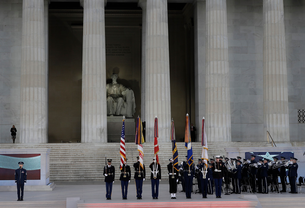 """. Colors are rendered at a pre-Inaugural \""""Make America Great Again! Welcome Celebration\"""" at the Lincoln Memorial in Washington, Thursday, Jan. 19, 2017. (AP Photo/David J. Phillip)"""