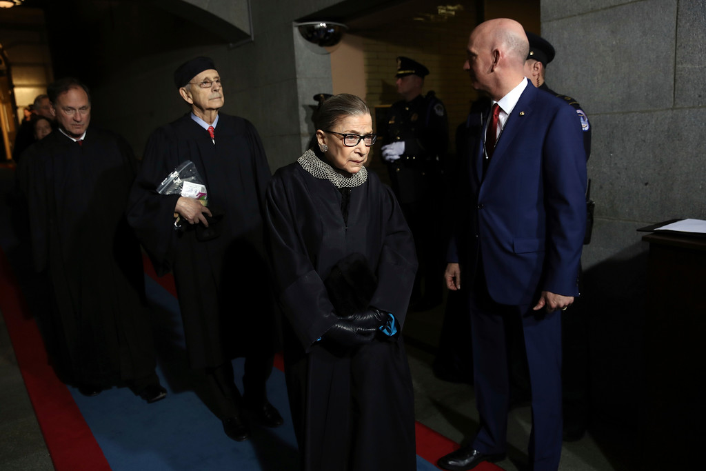 . Supreme Court justices, from left, Samuel Alito, Ruth Bader Ginsburg and Stephen Breyer arrive on the West Front of the U.S. Capitol on Friday, Jan. 20, 2017, in Washington, for his inauguration ceremony as the 45th president of the United States. (Win McNamee/Pool Photo via AP)