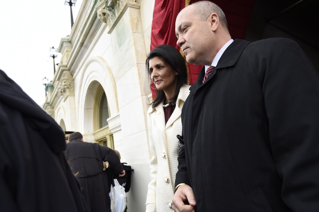 . US Ambassador-designate, South Carolina Gov. Nikki Haley and her husband Michael arrive on Capitol Hill in Washington, Friday, Jan. 20, 2017, for the presidential inauguration of Donald Trump. (Saul Loeb/Pool Photo via AP)