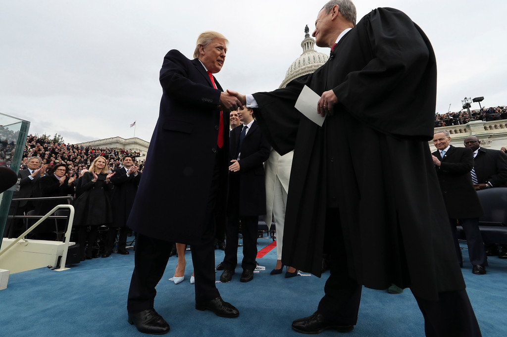. President Donald Trump shakes hands with Chief Justice John Roberts after taking the oath of office Friday, Jan. 27, 2017 on Capitol Hill in Washington. (Jim Bourg/Pool Photo via AP)