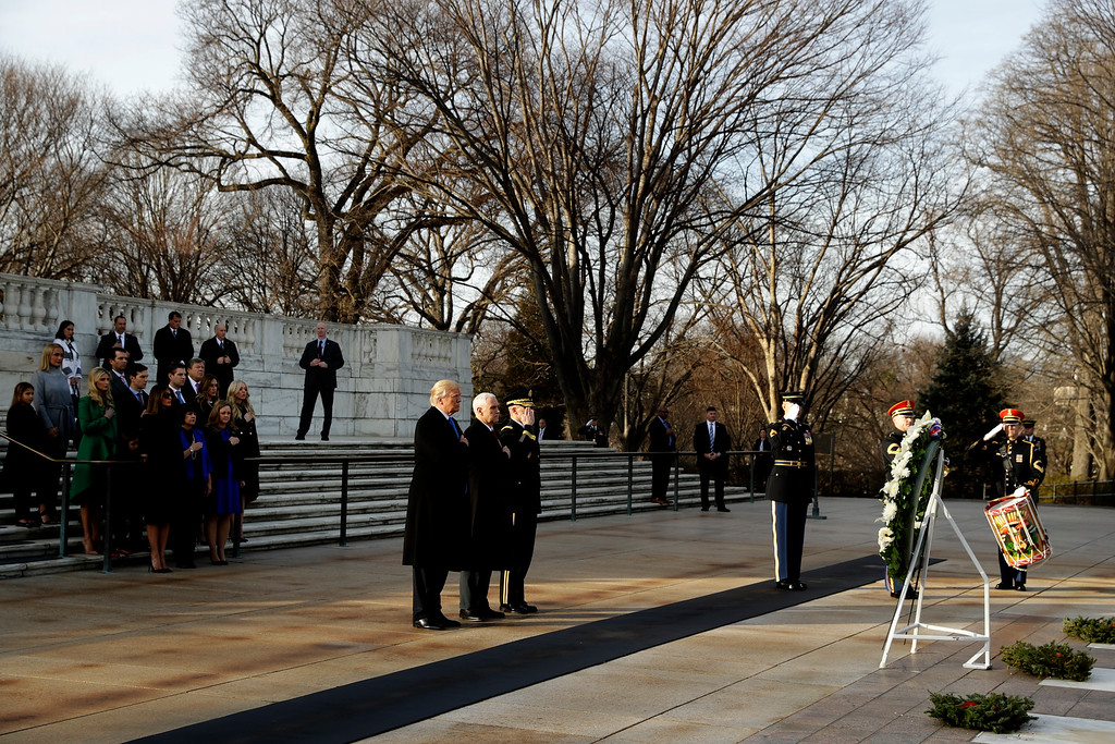 . President-elect Donald Trump, accompanied by Vice President-elect Mike Pence pauses after placing a wreath at the Tomb of the Unknowns, Thursday, Jan. 19, 2017, at Arlington National Cemetery in Arlington, Va., ahead of Friday\'s presidential inauguration. (AP Photo/Evan Vucci)