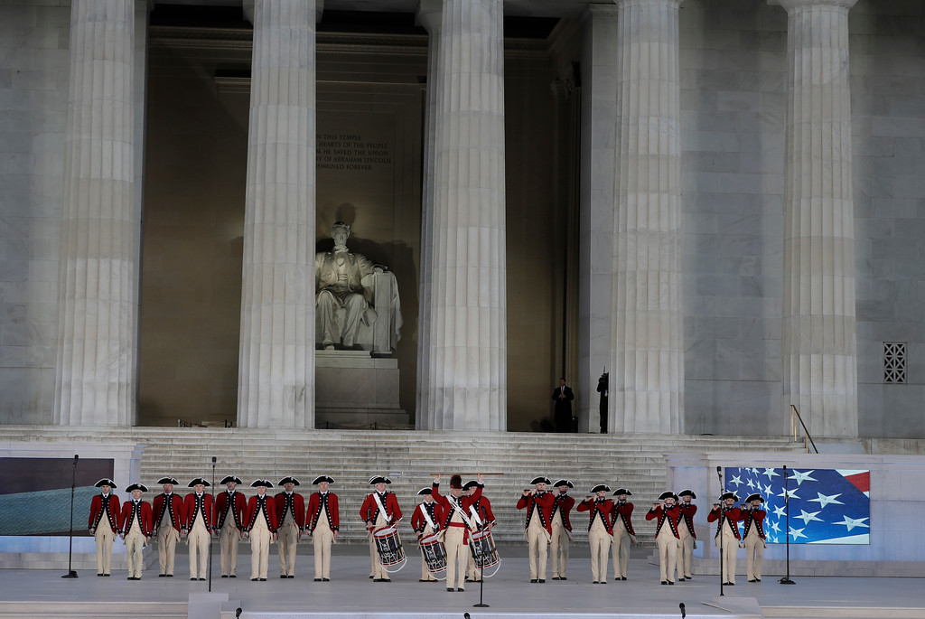 """. The U.S. Army Old Guard Fife and Drum Corps perform at a pre-Inaugural \""""Make America Great Again! Welcome Celebration\"""" at the Lincoln Memorial in Washington, Thursday, Jan. 19, 2017. (AP Photo/David J. Phillip)"""