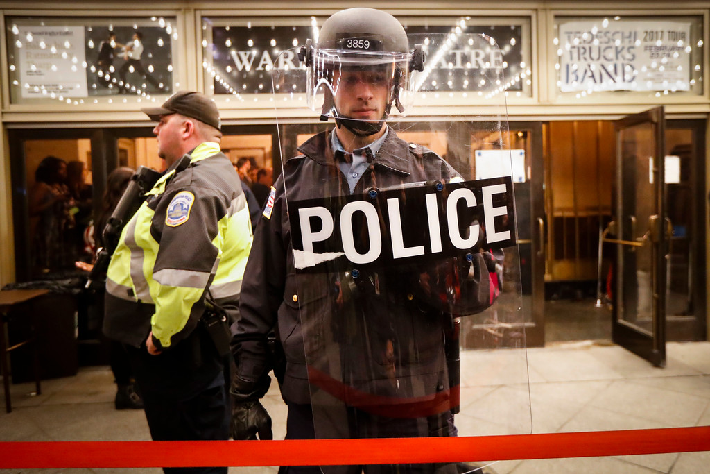 . Police stand guard at the rope line outside of an presidential inauguration party at the Warner Theatre due to street protests, Thursday, Jan. 19, 2017, in Washington. (AP Photo/John Minchillo)