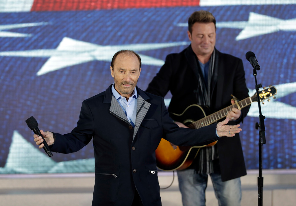 """. Lee Greenwood performs at a pre-Inaugural \""""Make America Great Again! Welcome Celebration\"""" at the Lincoln Memorial in Washington, Thursday, Jan. 19, 2017. (AP Photo/David J. Phillip)"""