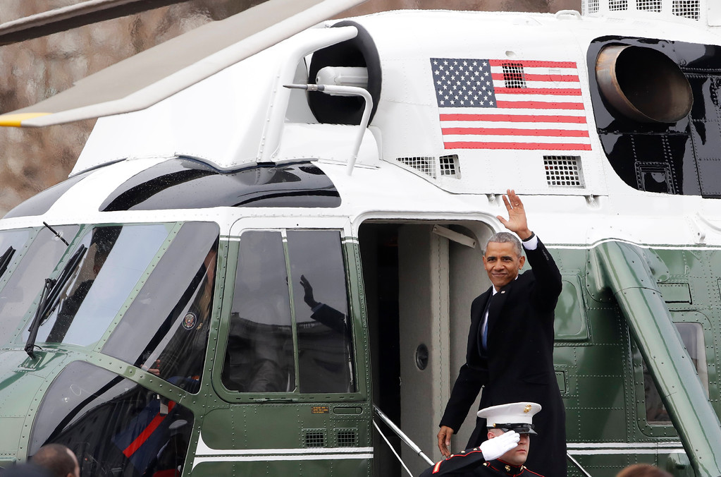 . Former president Barack Obama waves as he boards a Marine helicopter on the East Front of the Capitol, Friday, Jan. 20, 2017, in Washington, after Donald Trump was inaugurated. (AP Photo/Evan Vucci)