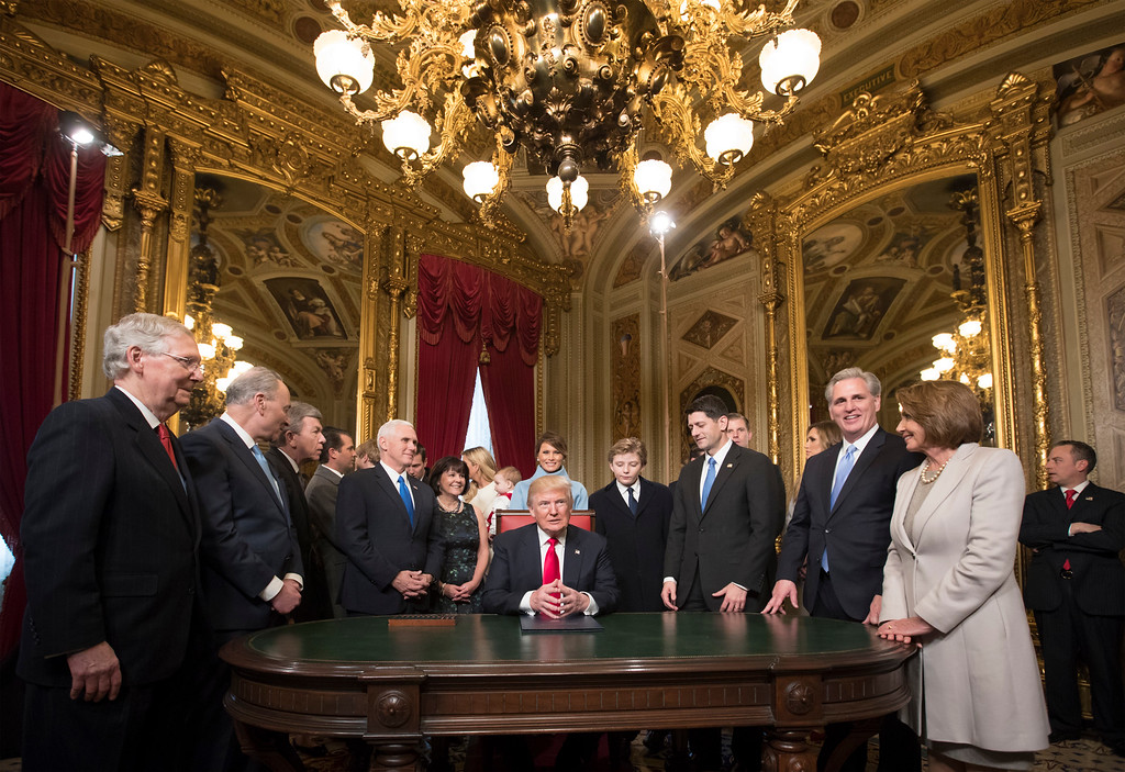 . President Donald Trump is joined by the Congressional leadership and his family as he formally signs his cabinet nominations into law, in the President\'s Room of the Senate, at the Capitol in Washington, Friday, Jan. 20, 2017. (AP Photo/Scott Applewhite, Pool)