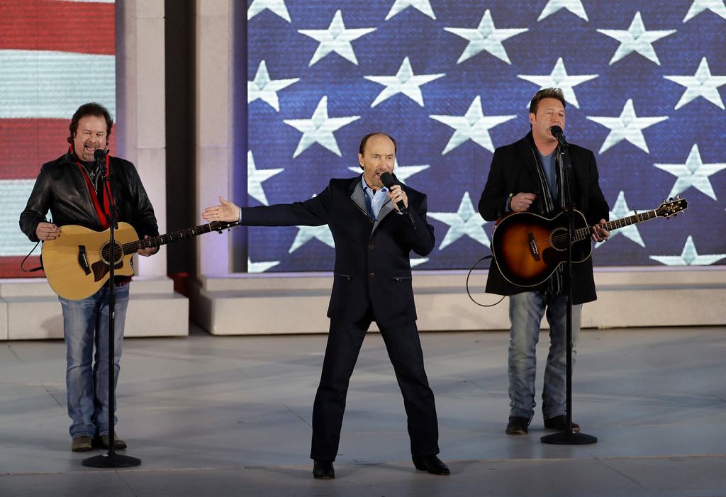 ". Lee Greenwood, center, performs at a pre-Inaugural ""Make America Great Again! Welcome Celebration\"" at the Lincoln Memorial in Washington, Thursday, Jan. 19, 2017. (AP Photo/David J. Phillip)"