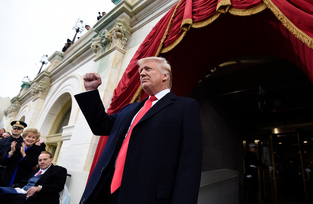 . US President-elect Donald Trump arrives for his Presidential Inauguration at the US Capitol in Washington, DC, on January 20, 2017. / AFP PHOTO / POOL / SAUL LOEB