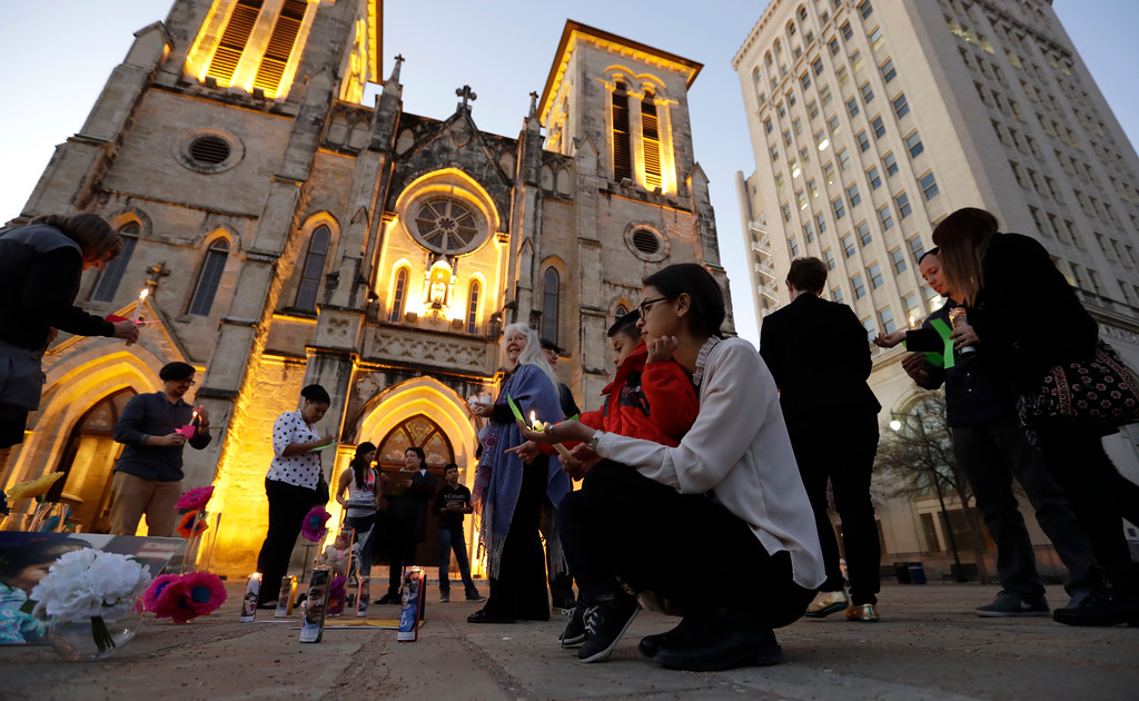 . Undocumented immigrants Ana Ortiz and her nephew, Rene, join community activists as they gather in front of San Fernando Cathedral for a vigil on the eve of President-elect Donald Trump\'s inauguration, Thursday, Jan. 19, 2017, in San Antonio. The group gathered to show their support for immigration groups, women\'s groups, minorities, and others they fear may be harmed by the new administration\'s policies. (AP Photo/Eric Gay)