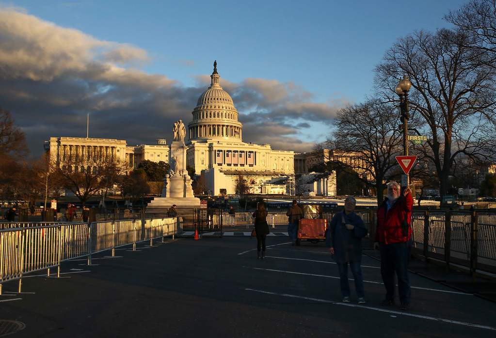 . The sun sets over the U.S. Capitol building in Washington D.C., on Wednesday, January 18, 2017. (Charlie Kaijo/The Tampa Bay Times via AP)