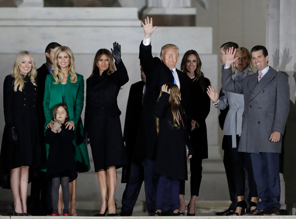 ". President-elect Donald Trump and his wife Melania Trump and family wave at the conclusion of the pre-Inaugural ""Make America Great Again! Welcome Celebration\"" at the Lincoln Memorial in Washington, Thursday, Jan. 19, 2017. (AP Photo/David J. Phillip)"