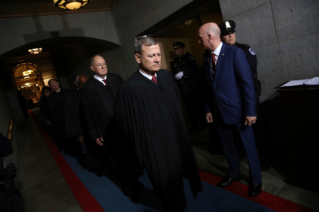 . Supreme Court Chief Justice John Roberts, right, and Justice Anthony Kennedy arrive on the West Front of the U.S. Capitol on Friday, Jan. 20, 2017, in Washington, for Donald Trump\'s inauguration ceremony as the 45th president of the United States. (Win McNamee/Pool Photo via AP)