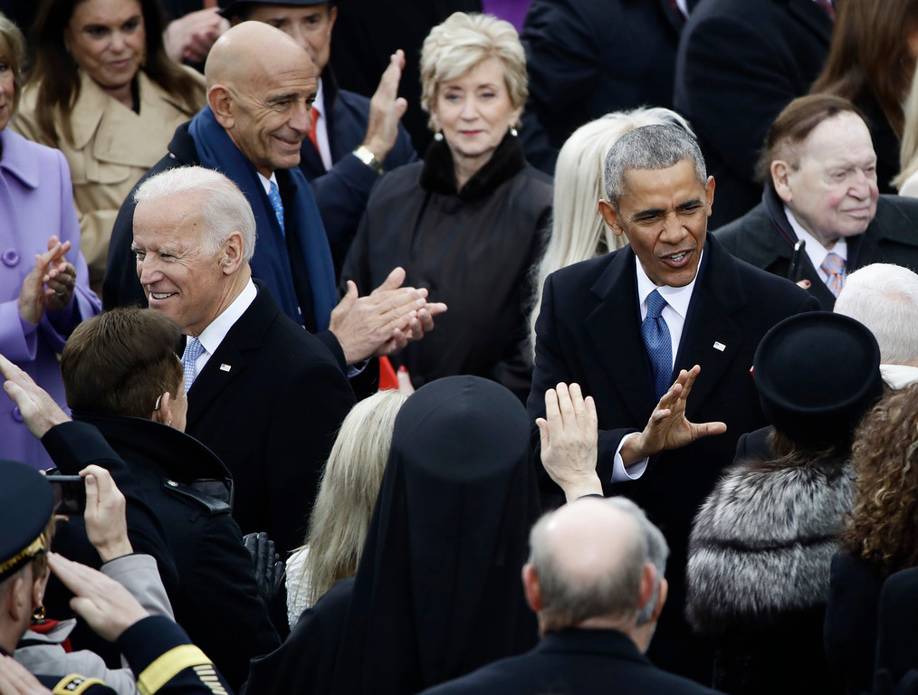 . President Barack Obama and Vice President Joe Biden arrive for the 58th Presidential Inauguration at the U.S. Capitol in Washington, Friday, Jan. 20, 2017. (AP Photo/Matt Rourke)