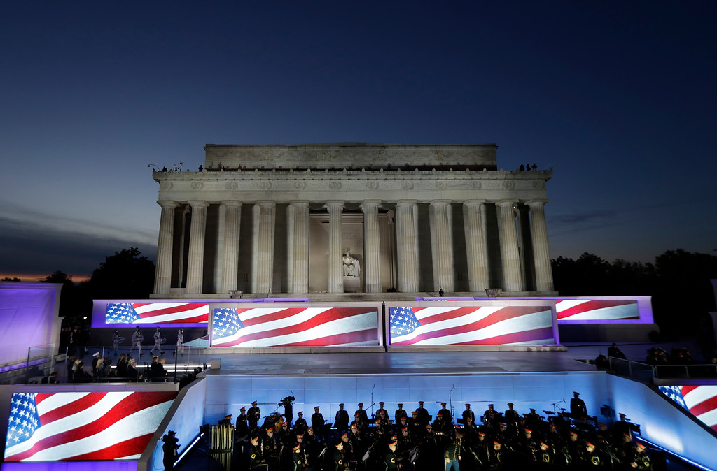 ". The Lincoln Memorial is seen at sunset during a pre-Inaugural ""Make America Great Again! Welcome Celebration\"" at the Lincoln Memorial in Washington, Thursday, Jan. 19, 2017. (AP Photo/David J. Phillip)"