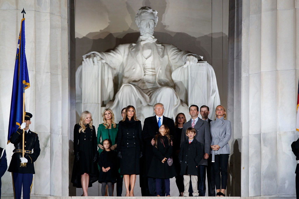 """. President-elect Donald Trump stands with his family during the \""""Make America Great Again Welcome Concert\"""" at the Lincoln Memorial, Thursday, Jan. 19, 2017, in Washington. (AP Photo/Evan Vucci)"""