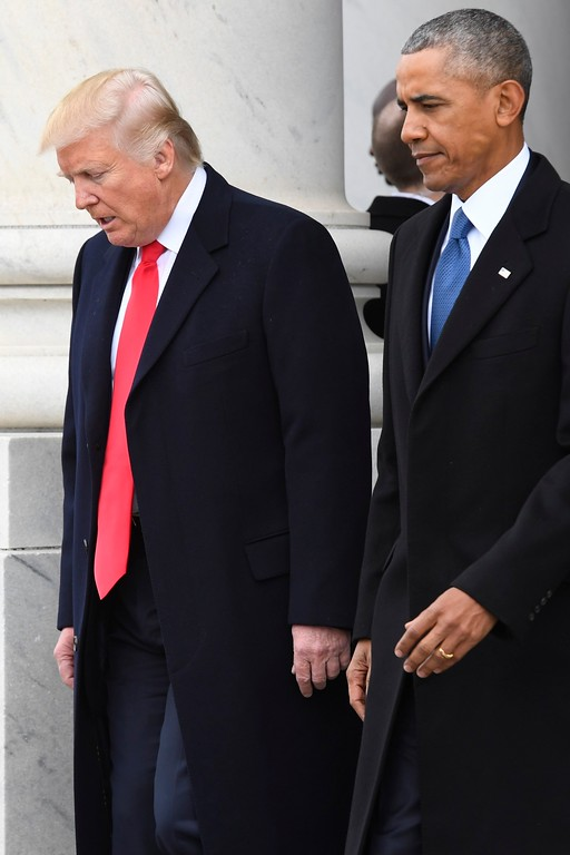 . President Donald Trump and former President Barack Obama walk out of the East front prior to Obama\'s departure from the 2017 Presidential Inauguration at the U.S. Capitol. (Jack Gruber/Pool Photo via AP)