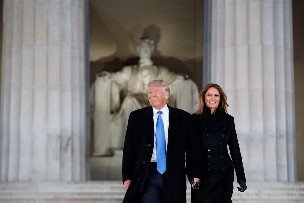 """. President-elect Donald Trump, left, and his wife Melania Trump arrive to the \""""Make America Great Again Welcome Concert\"""" at the Lincoln Memorial, Thursday, Jan. 19, 2017, in Washington. (AP Photo/Evan Vucci)"""