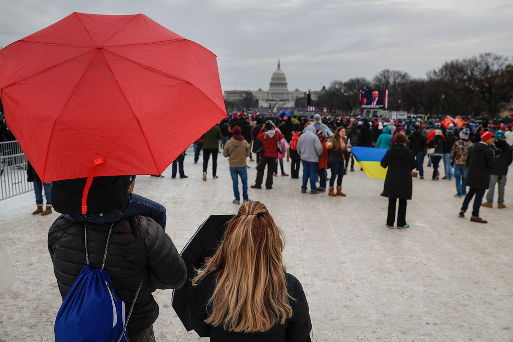 . Spectators gather on the National Mall in Washington, Friday, Jan. 20, 2107, as President Donald Trump speaks during his inauguration on Capitol Hill. (AP Photo/John Minchillo)