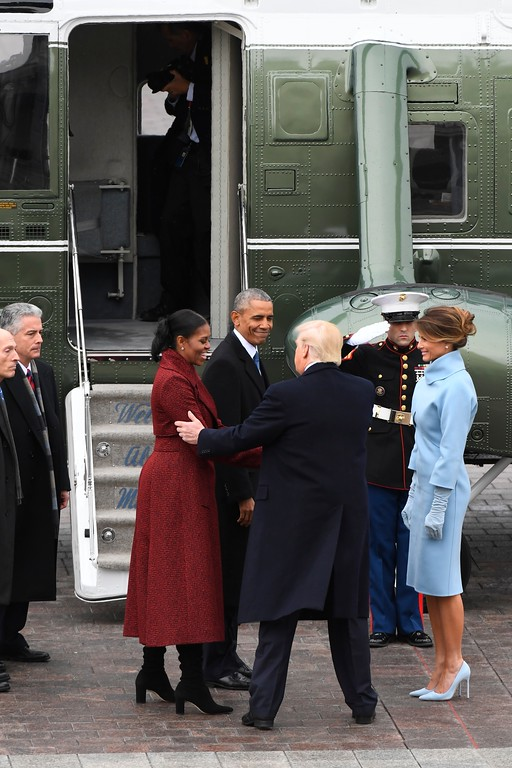 . Former President Barack Obama and Michelle Obama speak with President Donald Trump and Melania Trump in front of a Marine helicopter on Capitol Hill in Washington, Friday, Jan. 20, 2107, as the Obamas departs from the presidential inauguration . (Jack Gruber/Pool Photo via AP)