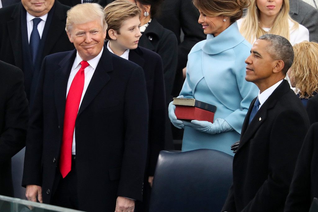 . President-elect Donald Trump looks over at President Barack Obama before being sworn in as the 45th president of the United States during the 58th Presidential Inauguration at the U.S. Capitol in Washington, Friday, Jan. 20, 2017. (AP Photo/Andrew Harnik)