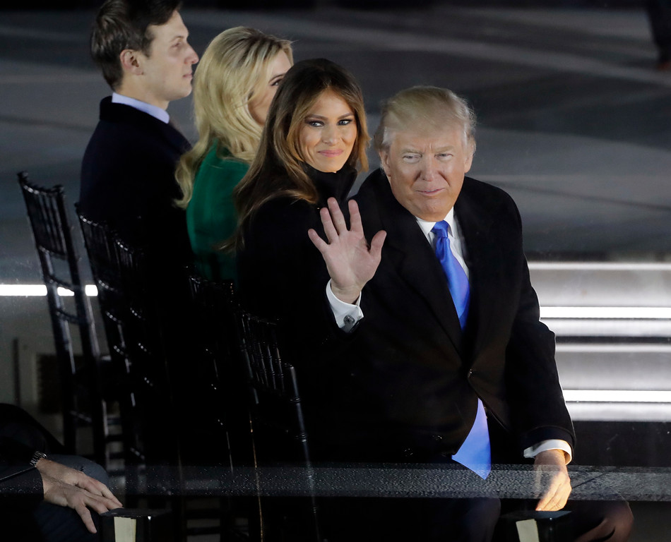 ". President-elect Donald Trump and his wife Melania Trump look to the crowd at a pre-Inaugural ""Make America Great Again! Welcome Celebration\"" at the Lincoln Memorial in Washington, Thursday, Jan. 19, 2017. Also on stage are Ivanka Trump and her husband Jared Kushner. (AP Photo/David J. Phillip)"