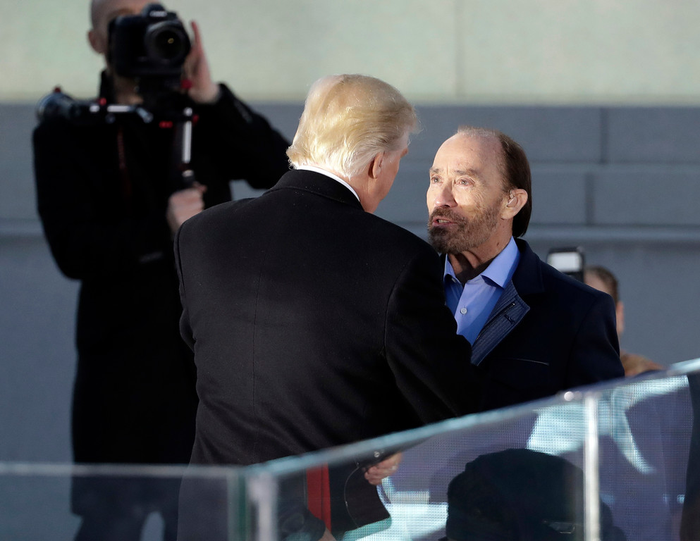 """. President-elect Donald Trump greets singer Lee Greenwood, right, after he performed at a pre-Inaugural \""""Make America Great Again! Welcome Celebration\"""" at the Lincoln Memorial in Washington, Thursday, Jan. 19, 2017. (AP Photo/David J. Phillip)"""