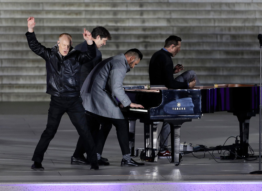 """. The Piano Guys perform at a pre-Inaugural \""""Make America Great Again! Welcome Celebration\"""" at the Lincoln Memorial in Washington, Thursday, Jan. 19, 2017. (AP Photo/David J. Phillip)"""