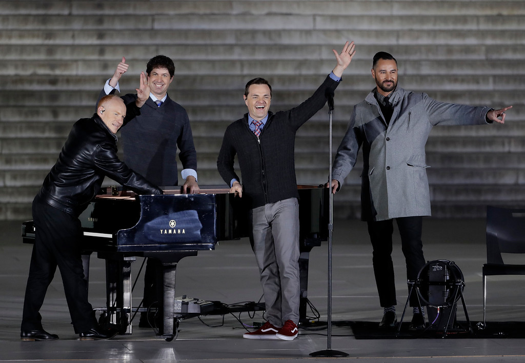 """. The Piano Guys perform arrive at a pre-Inaugural \""""Make America Great Again! Welcome Celebration\"""" at the Lincoln Memorial in Washington, Thursday, Jan. 19, 2017. (AP Photo/David J. Phillip)"""
