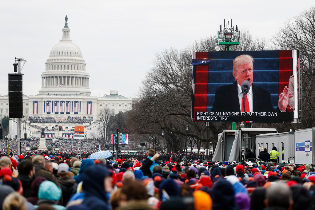 . President-elect Donald Trump is seen speaking on video monitor on the National Mall during his inauguration, Friday, Jan. 20, 2017, in Washington. (AP Photo/John Minchillo)