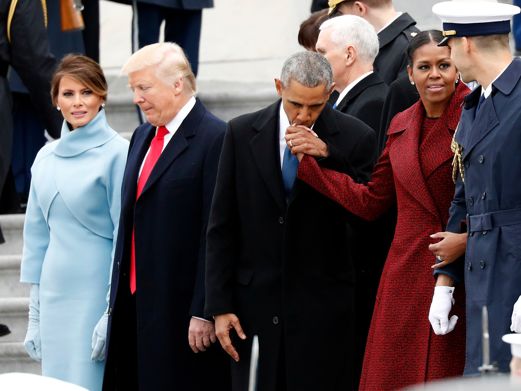 . First lady Melania Trump stands with President Donald Trump as former President Barack Obama kisses the hand of his wife Michelle Obama, during a departure ceremony on the East Front of the U.S. Capitol, Friday, Jan. 20, 2017 in Washington. (AP Photo/Alex Brandon)