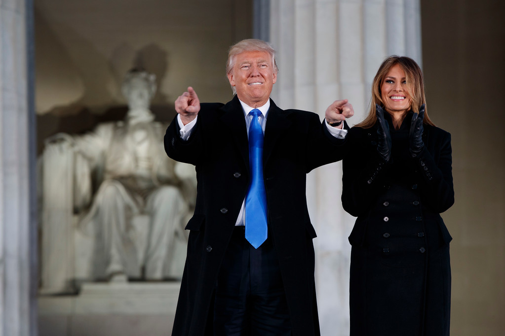 ". President-elect Donald Trump, left, and his wife Melania Trump arrive to the ""Make America Great Again Welcome Concert\"" at the Lincoln Memorial, Thursday, Jan. 19, 2017, in Washington. (AP Photo/Evan Vucci)"
