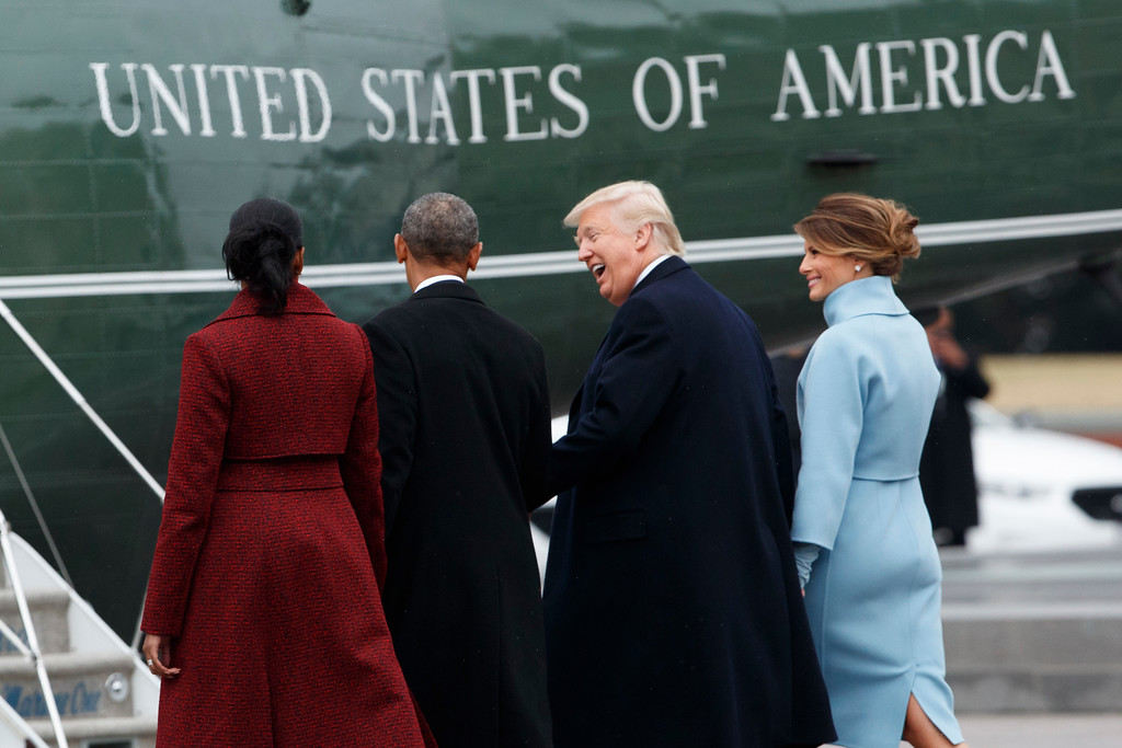 . President Donald Trump and first lady Melania Trump walks former President Barack Obama and Michelle Obama to a Marine helicopter during a departure ceremony on the East Front of the U.S. Capitol, Friday, Jan. 20, 2017, in Washington. (AP Photo/Evan Vucci)