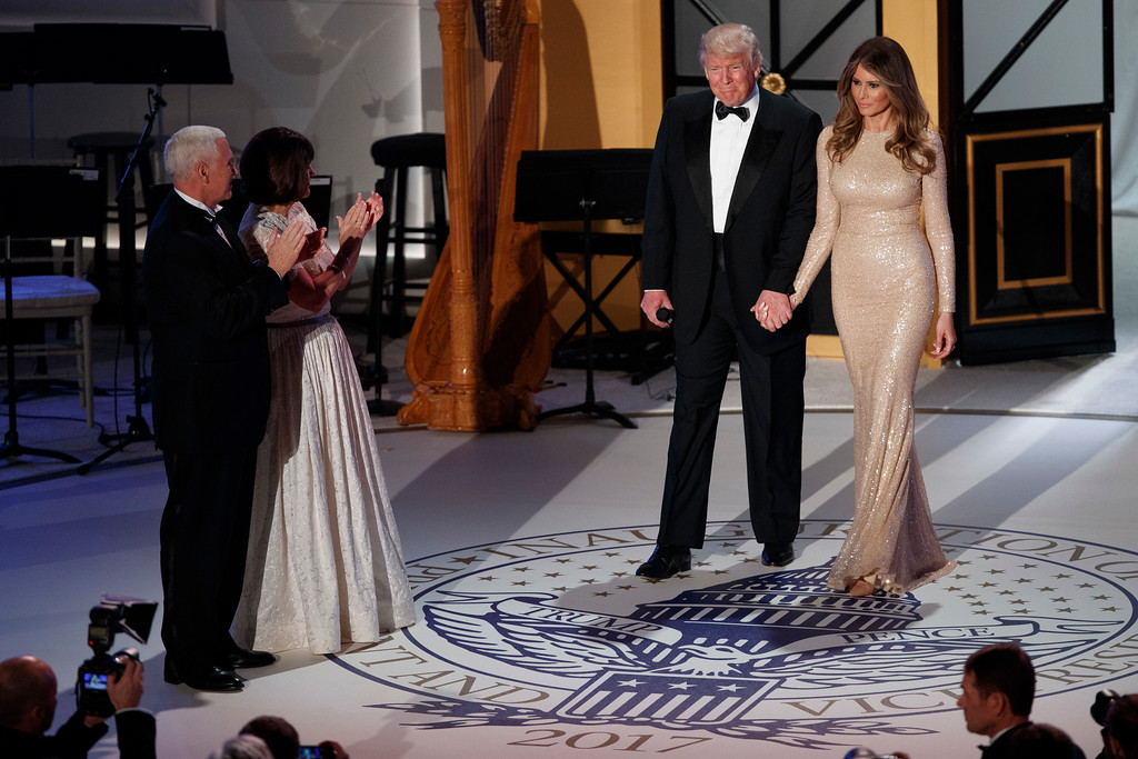 . Vice President-elect Mike Pence, left, and his wife Karen, second from left, applaud as President-elect Donald Trump and his wife Melania arrive for a VIP reception and dinner with donors, Thursday, Jan. 19, 2017, in Washington. (AP Photo/Evan Vucci)