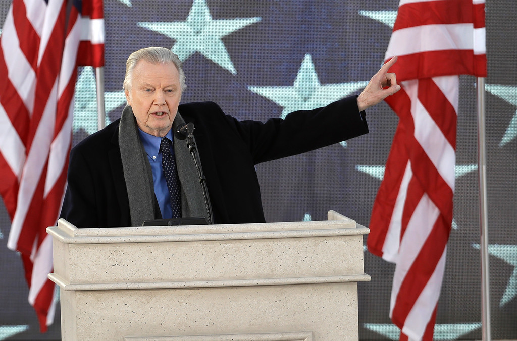 """. Jon Voight waves as he appears during a pre-Inaugural \""""Make America Great Again! Welcome Celebration\"""" at the Lincoln Memorial in Washington, Thursday, Jan. 19, 2017. (AP Photo/David J. Phillip)"""