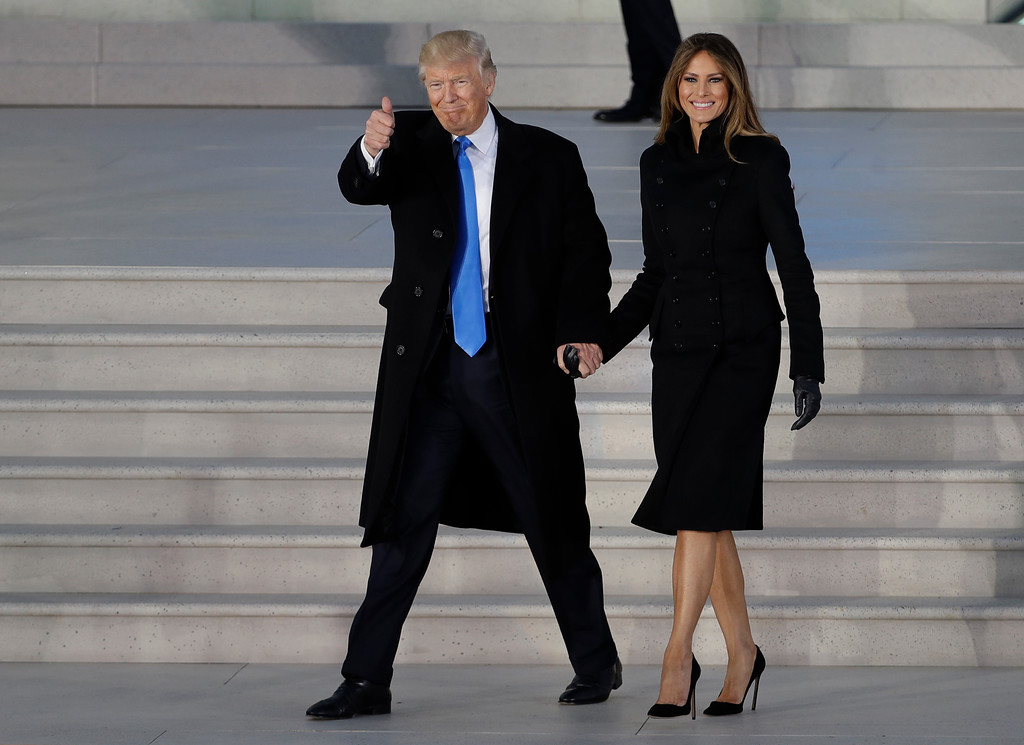 """. President-elect Donald Trump and his wife Melania Trump arrive at a pre-Inaugural \""""Make America Great Again! Welcome Celebration\"""" at the Lincoln Memorial in Washington, Thursday, Jan. 19, 2017. (AP Photo/David J. Phillip)"""