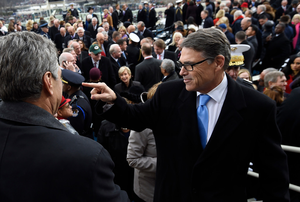 . Energy Secretary-designate, former Texas Gov. Rick Perry leaves Capitol Hill in Washington, Friday, Jan. 20, 2017, after the presidential inauguration of Donald Trump. (Saul Loeb/Pool Photo via AP)