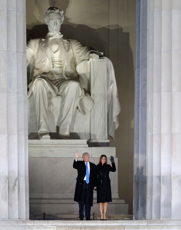 ". President-elect Donald Trump and his wife Melania Trump wave at a pre-Inaugural ""Make America Great Again! Welcome Celebration\"" at the Lincoln Memorial in Washington, Thursday, Jan. 19, 2017. (AP Photo/David J. Phillip)"