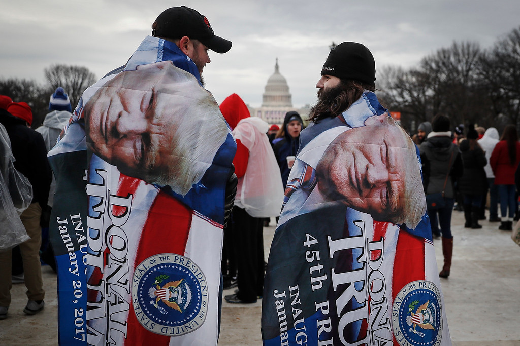 . Spectators gather on the National Mall in Washington, Friday, Jan. 20, 2017, before the presidential inauguration of Donald Trump as the 45th president of the United States. (AP Photo/John Minchillo)