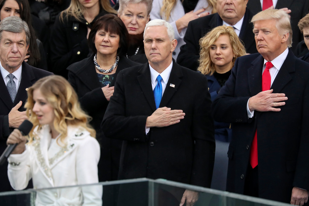 . Vice President Mike Pence and President Donald Trump listen to the singing of the national anthem by Jackie Evancho during the 58th Presidential Inauguration at the U.S. Capitol in Washington, Friday, Jan. 20, 2017. (AP Photo/Andrew Harnik)