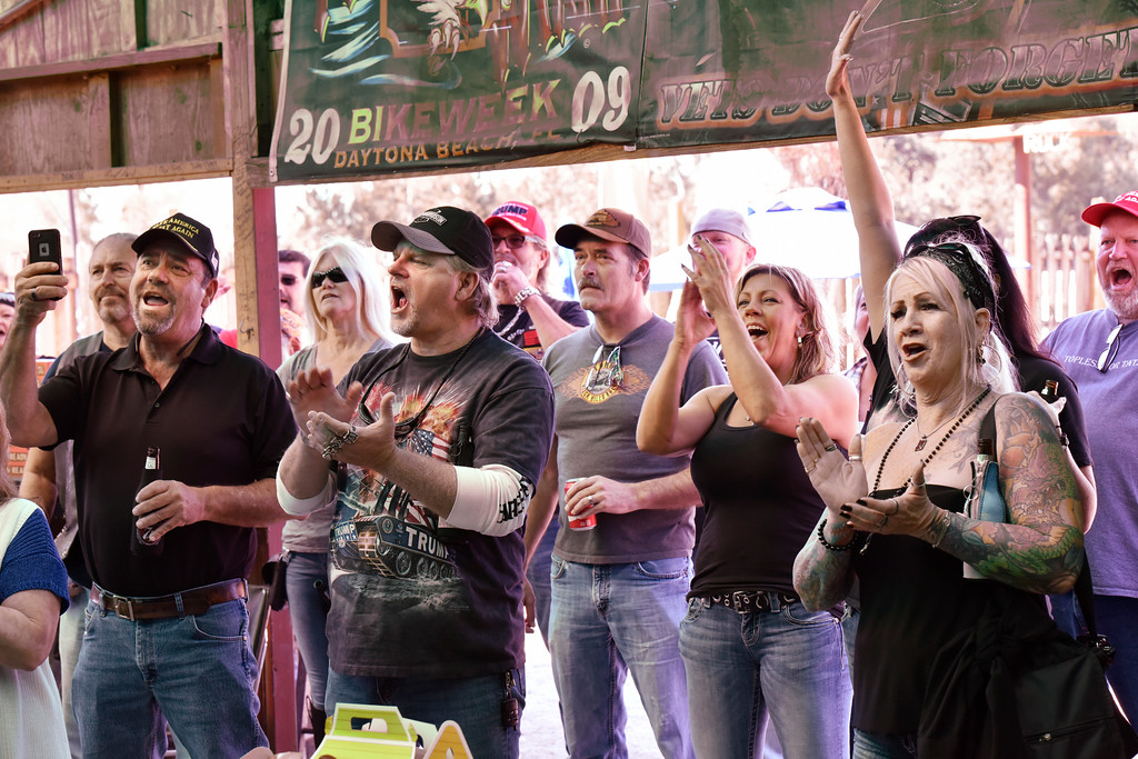 . Patrons at the Bayard Rooster in in Jacksonville, Fla,  cheer as they watch President Donald Trump is inaugurated. (Will Dickey /The Florida Times-Union via AP)